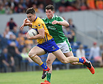 Jamie Malone of Clare in action against Iain Corbett of Limerick during their Munster championship quarter-final game in Cusack park. Photograph by John Kelly.