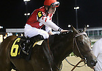 April 26, 2014 Jockey Brian Hernandez Jr. pats  his horse Embellishing Bob after the Derby Trial at Churchill Downs.  He was the winner by disqualification.  Owner Martin L. Cherry, trainer Steve Margolis