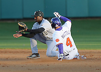 Thomas Brittle (4) of the Clemson Tigers steals second base with second baseman Demetrius Jennings (1) defending in the seventh inning of a game on Wednesday, March 6, 2013, at Doug Kingsmore Stadium in Clemson, South Carolina. Clemson won, 9-2. (Tom Priddy/Four Seam Images)