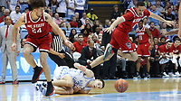 CHAPEL HILL, NC - FEBRUARY 25: Devon Daniels #24 and Jericole Hellems #4 of North Carolina State University challenge for a loose ball with Justin Pierce #32 of the University of North Carolina during a game between NC State and North Carolina at Dean E. Smith Center on February 25, 2020 in Chapel Hill, North Carolina.