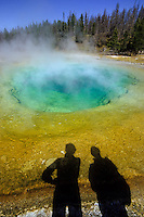 Morning Glory Pool in Yellowstone with the shadow of two tourists watching it foto, reise, photograph, image, images, photo,<br />