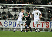 Pictured: Garry Monk of Swansea pushing Mounir El Haimour (C) which earned the former a yellow card from referee G D Horwood<br /> Re: Coca Cola Championship, Swansea City FC v Barnsley at the Liberty Stadium. Swansea, south Wales, Tuesday 09 December 2008.<br /> Picture by D Legakis Photography / Athena Picture Agency, Swansea 07815441513