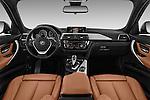 Stock photo of straight dashboard view of 2016 BMW 3-Series 328i-xDrive-Sports-Wagon 5 Door Wagon Dashboard