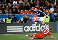 22 April 2009: Chivas USA midfielder Sacha Kljestan #16 leaps over Toronto FC midfielder Carl Robinson #33 at BMO Field in a MLS game between Chivas USA and Toronto FC.Toronto FC won 1-0. .
