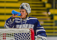 14 February 2015: University of New Hampshire Wildcat Goaltender Vilma Vaattovaara, a Junior from Veikkola, Finland, hydrates during a play stoppage against the University of Vermont Catamounts at Gutterson Fieldhouse in Burlington, Vermont. The Ladies played to a 3-3 tie in their final meeting of the NCAA Hockey East season. Mandatory Credit: Ed Wolfstein Photo *** RAW (NEF) Image File Available ***