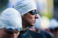 28 JUN 2012 - LONDON, GBR - Richard Stannard waits for the start of  the elite men's 2012 Canary Wharf Triathlon second heat at Canary Wharf in London, Great Britain (PHOTO (C) 2012 NIGEL FARROW)