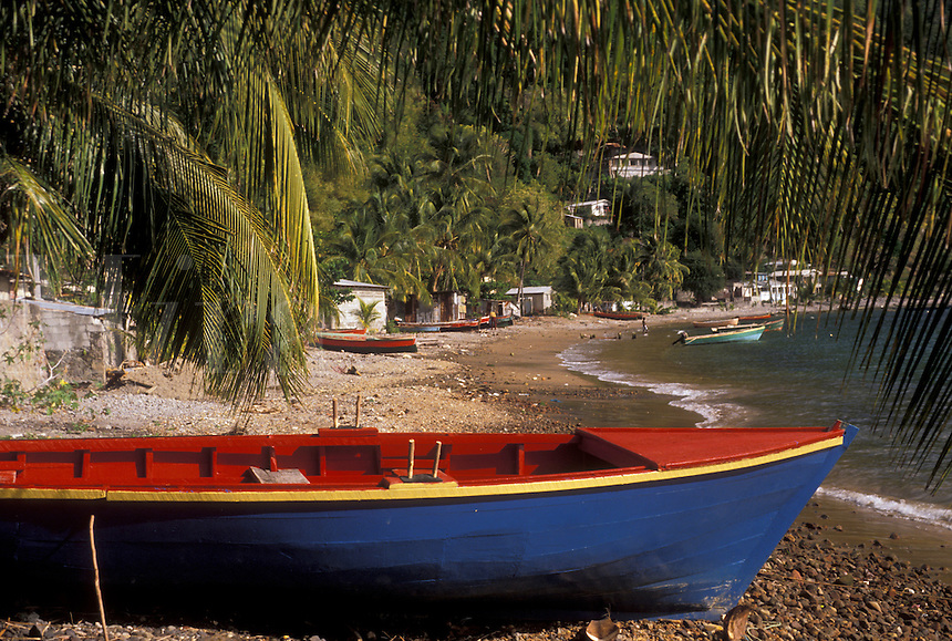 AJ2493, Dominica, Caribbean, Caribbean Islands, Colorful blue, yellow and red fishing boat on the beach in Soufriere on the island of Dominica.