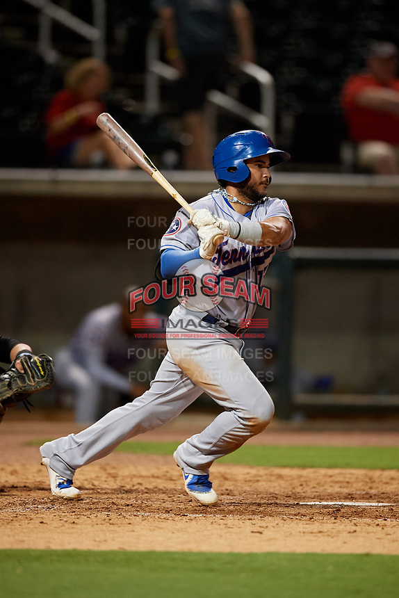 Tennessee Smokies third baseman Vimael Machin (13) follows through on a swing during a game against the Birmingham Barons on August 16, 2018 at Regions FIeld in Birmingham, Alabama.  Tennessee defeated Birmingham 11-1.  (Mike Janes/Four Seam Images)