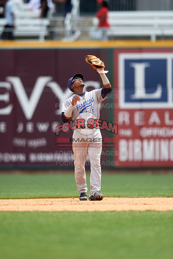 Pensacola Blue Wahoos second baseman Shed Long (4) settles under a pop up during a game against the Birmingham Barons on May 9, 2018 at Regions Field in Birmingham, Alabama.  Birmingham defeated Pensacola 16-3.  (Mike Janes/Four Seam Images)