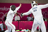 12 AUG 2012 - LONDON, GBR - Mhairi Spence (GBR) (left) of Great Britain and Lena Schoneborn of Germany compete during their women's London 2012 Olympic Games Modern Pentathlon fencing match at The Copper Box in the Olympic Park, in Stratford, London, Great Britain (PHOTO (C) 2012 NIGEL FARROW)