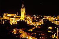 France, Saint Emilion, Bordeaux Wine Region, Gironde, Aquitaine, Europe, The medieval village of St. Emilion and Eglise Monolithe illuminated at night.