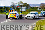 Garda Brendan Houlihan and Garda Garvan Kelleher at a checkpoint at Leith roundabout in Tralee on Tuesday.