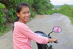 Young Girl Scooter Driver, Phnom Sampeau Pagoda