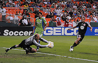 Seattle Sounder FC. goalkeeper Kasey Keller (18) makes a save from a ball kick by DC United midfielder Fred (7).  The Seattle Sounders FC defeated DC United 2-1at RFK Stadium, Saturday September 12 , 2009.