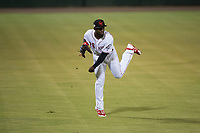 Scottsdale Scorpions left fielder Taylor Trammell (26), of the Cincinnati Reds organization, throws to the infield during an Arizona Fall League game against the Mesa Solar Sox on October 9, 2018 at Scottsdale Stadium in Scottsdale, Arizona. The Solar Sox defeated the Scorpions 4-3. (Zachary Lucy/Four Seam Images)