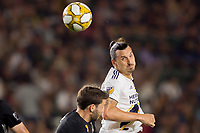 CARSON, CA - SEPTEMBER 15: Zlatan Ibrahimovic #9 of the Los Angeles Galaxy heads a ball during a game between Sporting Kansas City and Los Angeles Galaxy at Dignity Health Sports Park on September 15, 2019 in Carson, California.