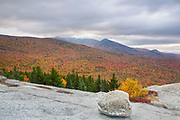 Autumn foliage on a cloudy day from Middle Sugarloaf Mountain in Bethlehem, New Hampshire during the autumn months.