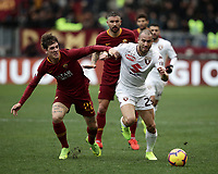 Football, Serie A: AS Roma - Torino, Olympic stadium, Rome, January 19, 2019. <br /> Roma's Nicolò Zaniolo (l) in action with Torino's Lorenzo De Silvestri (r) during the Italian Serie A football match between AS Roma and Torino at Olympic stadium in Rome, on January 19, 2019.<br /> UPDATE IMAGES PRESS/Isabella Bonotto