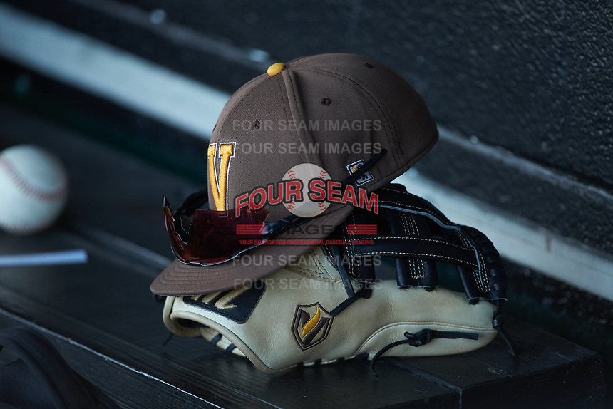 A Valparaiso Crusaders cap sits on top of a glove in the visitors dugout during the game against the Western Kentucky Hilltoppers at Nick Denes Field on March 19, 2021 in Bowling Green, Kentucky. (Brian Westerholt/Four Seam Images)