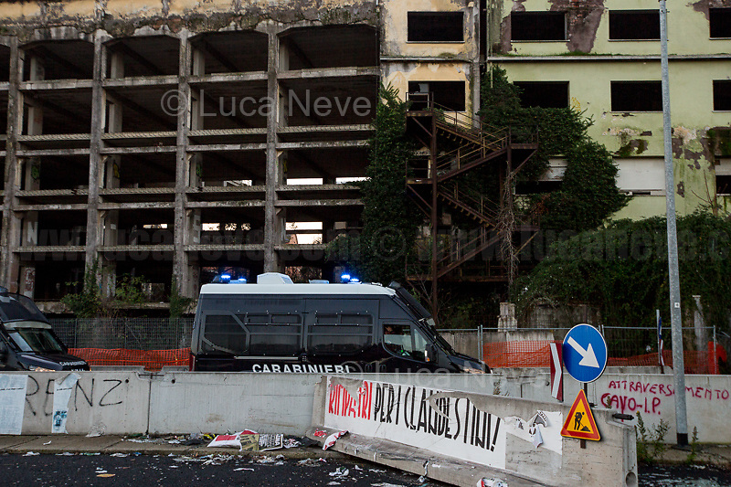 (On the R) Posters by the neo-fascist group Casapound.<br /> <br /> Rome, 10/12/2018. Today, the derelict former factory of the Penicillin in the east area of Rome was evicted and evacuated by a conspicuous number police officers in full riot gears (Polizia and Carabinieri) supported by fire fighters and the Rome municipal police. The abandoned and run-down factory once was home to an estimated 500 people, including migrants of different nationalities but also Italian families who lived in extreme poverty and poor hygienic and health conditions (presence of asbestos and others). The eviction, which saw the last 35 inhabitants took away on a bus by the police, was attended by the far-right leader of League (Lega), anti-immigration Minister of the Interiors and Deputy Prime Minister, Matteo Salvini. A group of protesters and activists held a rally against the eviction without a plan to rehouse the people of the Ex Penicillin but it was kept away from the main gate of the raw-concrete skeleton building.<br /> On the same day the 70th Anniversary of the Universal Declaration of Human Rights (UDHR, 1.), was marked outside the Colosseum projecting the Article 1 of the Declaration on the Historic symbol of Rome: <<All human beings are born free and equal in dignity and rights. They are endowed with reason and conscience and should act towards one another in a spirit of brotherhood>> (2.).<br /> <br /> 1. http://www.un.org/en/udhrbook/pdf/udhr_booklet_en_web.pdf<br /> 2. See my Story here: https://bit.ly/2PyLWeK