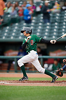 Great Lakes Loons second baseman Moises Perez (14) follows through on a swing during a game against the Burlington Bees on May 4, 2017 at Dow Diamond in Midland, Michigan.  Great Lakes defeated Burlington 2-1.  (Mike Janes/Four Seam Images)