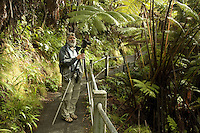 Volcano Man and renowned photographer G. Brad Lewis taking photographs near the Thurston Lava Tube of the Hawaii Volcanoes National Park