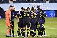 KANSAS CITY, KS - OCTOBER 11: Nashville SC players in a huddle during a game between Nashville SC and Sporting Kansas City at Children's Mercy Park on October 11, 2020 in Kansas City, Kansas.