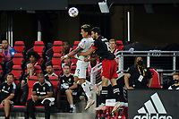 WASHINGTON, DC - JULY 7: Barlon Sequeira #22 of Liga Deportiva Alajuense heads the ball against Steven Birnbaum #15 of D.C. United during a game between Liga Deportiva Alajuense  and D.C. United at Audi Field on July 7, 2021 in Washington, DC.