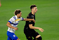 LOS ANGELES, CA - SEPTEMBER 02: Tristan Blackmon #27 of LAFC and Cade Cowell #44 of San Jose Earthquakes battle for a head ball during a game between San Jose Earthquakes and Los Angeles FC at Banc of California stadium on September 02, 2020 in Los Angeles, California.