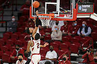 Arkansas forward Vance Jackson Jr. (2) blocks Georgia Toumani Camara (10), Saturday, January 9, 2021 during the first half of a basketball game at Bud Walton Arena in Fayetteville. Check out nwaonline.com/210110Daily/ for today's photo gallery. <br /> (NWA Democrat-Gazette/Charlie Kaijo)