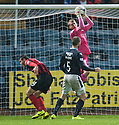 Dundee's James McPake pushes St Johnstone's Brian Graham for the penalty.