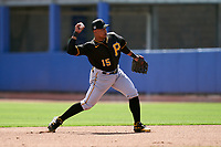 Pittsburgh Pirates second baseman Wilmer Difo (15) throws to first base during a Major League Spring Training game against the Toronto Blue Jays on March 1, 2021 at TD Ballpark in Dunedin, Florida.  (Mike Janes/Four Seam Images)
