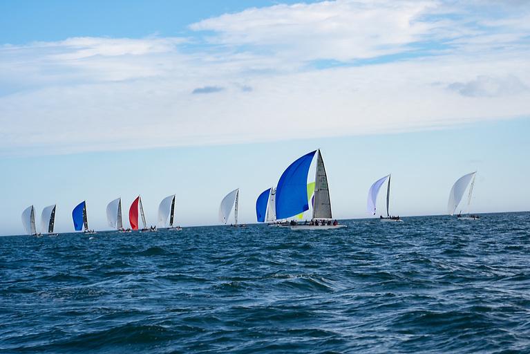 Full Irish IRL 1748 David Kenefick leading a split gybe in the fleet downwind