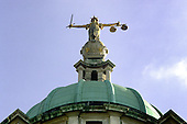 The figure of justice on top of the Old Bailey Court in London