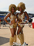 A couple of roller skating fans pose for a picture before the Samsung Mobile 500 Sprint Cup race at Texas Motor Speedway in Fort Worth,Texas.