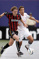 The MetroStars' Eddie Gaven is chased by the Revolution's Brian Kamler. The New England Revolution were defeated by the MetroStars 3 to 2 on Saturday September 11, 2004 at Giant's Stadium, East Rutherford, NJ..