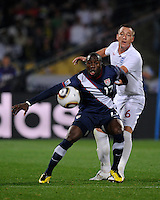 Jozy Altidore (17) of USA tries control the ball ahead John Terry (6) of England. USA vs England in the 2010 FIFA World Cup at Royal Bafokeng Stadium in Rustenburg, South Africa on June 12, 2010.