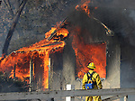 An estimated 25 homes were lost in a 2,000-acre brush fire in south Reno, Nev., on Friday, Nov. 18, 2011.  (AP Photo/Cathleen Allison)