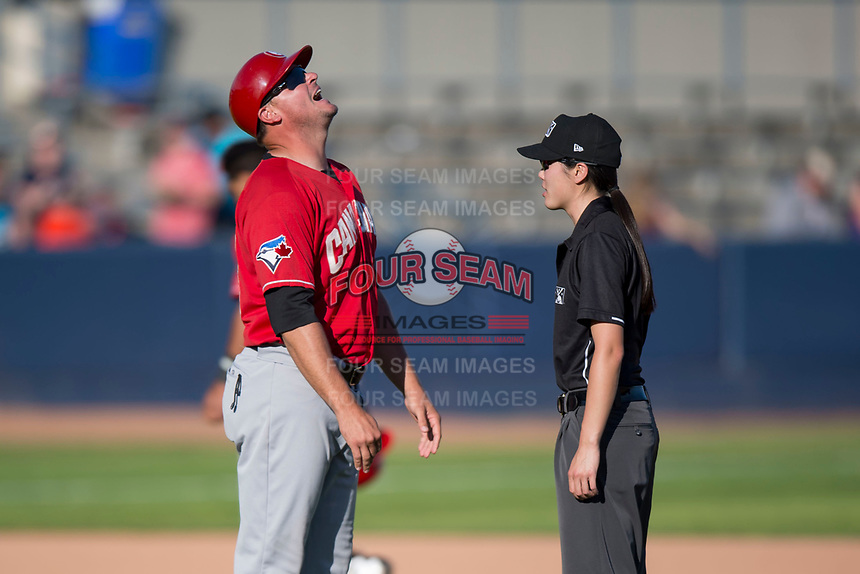Vancouver Canadians manager Dallas McPherson (23) shows his frustration with a call made by field umpire Emma Charlesworth-Seiler during a Northwest League game against the Spokane Indians at Avista Stadium on September 2, 2018 in Spokane, Washington. The Spokane Indians defeated the Vancouver Canadians by a score of 3-1. (Zachary Lucy/Four Seam Images)