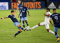 CARSON, CA - OCTOBER 18: Fredy Montero #12 of the Vancouver Whitecaps and Carlos Harvey #67 of the Los Angeles Galaxy meet during a game between Vancouver Whitecaps and Los Angeles Galaxy at Dignity Heath Sports Park on October 18, 2020 in Carson, California.