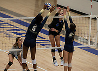 Trinity Luckett (5) of Bentonville West blocks spike of Ella Mcleod (9) of Rogers at Rogers High School, Rogers, AR, on Thursday, September 9, 2021 / Special to NWADG David Beach