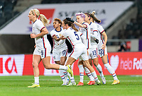 SOLNA, SWEDEN - APRIL 10: Megan Rapinoe #15 of the USWNT celebrates with Kelley O'Hara #5 during a game between Sweden and USWNT at Friends Arena on April 10, 2021 in Solna, Sweden.