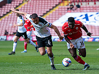 24th April 2021, Oakwell Stadium, Barnsley, Yorkshire, England; English Football League Championship Football, Barnsley FC versus Rotherham United; Daryl Dike of Barnsley challenges Richard Wood of Rotherham