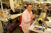 Bacau/Romania<br /> La Sonoma, industria tessile dove vengono prodotti capi di lusso per vari marchi importanti del 'Made in Italy', è un vero esempio di globalizzazione nel mondo del lavoro: fabbrica rumena, AD italiano, operai provenienti da Cina e Bangladesh. I lavoratori rumeni sono diventati una minoranza perchè costano troppo. Gli operai asiatici costano la metà e lavorano su tre turni, sette giorni alla settimana.<br /> Sonoma textil factory in Bacau is an example of globalization: italian AD, romanian factory, workers from Chine and Bangladesh. In the picture some rumanian workers become the minority becouse of the salary. The cost of workers coming from Asia is half and they can work more hours and seved days a week. Photo Livio Senigalliesi