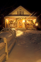 AJ5882, Stowe, holiday, gift shop, ski resort, evening, snow, decorations, Christmas, winter, Vermont, A boutique is decorated for the Christmas holiday season in Stowe Village on a snow covered night in Lamoille County in the state of Vermont.