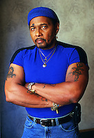 AARON NEVILLE's famous mole and well-adorned body present itself to the camera in Manhattan hotel room where he is situated while on tour, and promoting new album and book..Mayflower Hotel, Central Park West, NYC.Newsday/ARI MINTZ  9/13/00