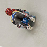 4 December 2015: Toni Eggert and Sascha Benecken, sliding for Germany, bank into a turn on their first run of the Doubles Competition, moving into first place by 11/1000 of a second during the Viessmann Luge World Cup Series at the Olympic Sports Track in Lake Placid, New York, USA. The German team posted a combined time of 1:27.583 to win the Doubles Competition. Mandatory Credit: Ed Wolfstein Photo *** RAW (NEF) Image File Available ***