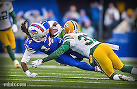 14 December 2014: Buffalo Bills wide receiver Sammy Watkins is tackled after receiving a pass for a 28-yard gain in the second quarter against the Green Bay Packers at Ralph Wilson Stadium in Orchard Park, NY. The Bills defeated the Packers 21-13, snapping the Packers' 5-game winning streak and keeping the Bills' 2014 playoff hopes alive. Ed Wolfstein Photo. Original shot Nikon D4 RAW (NEF)