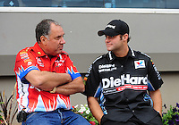 Sept. 18, 2011; Concord, NC, USA: NHRA funny car driver Johnny Gray (left) talks with Matt Hagan during the O'Reilly Auto Parts Nationals at zMax Dragway. Mandatory Credit: Mark J. Rebilas-