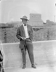 DAKOTA TALBERT. Dapper young Dakota Talbert casually checks his pocket watch. Also see image LB143<br /> <br /> Photographs taken on black and white glass negatives by African American photographer(s) John Johnson and Earl McWilliams from 1910 to 1925 in Lincoln, Nebraska. Douglas Keister has 280 5x7 glass negatives taken by these photographers. Larger scans available on request.